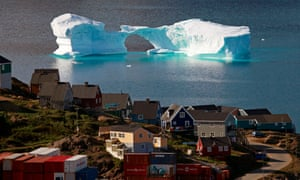 An iceberg floats near a harbour in the town of Kulusuk, east Greenland, 1 August 2009.
