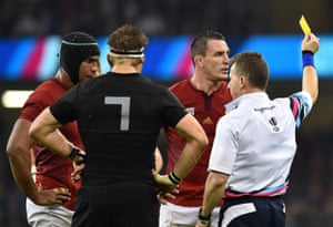 Louis Picamoles receives a yellow card from referee Nigel Owens.