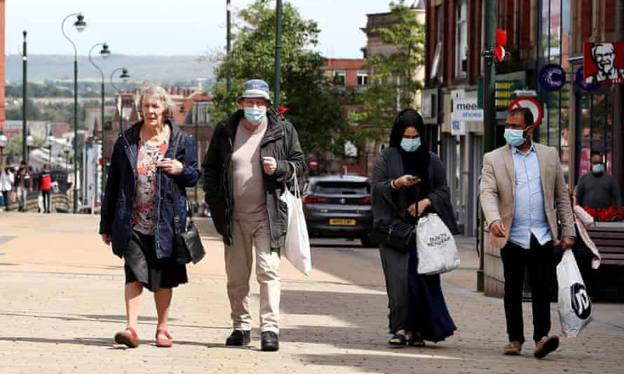 People shopping in Oldham, Greater Manchester.
