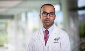 haider warraich in a hospital corridor wearing a labcoat