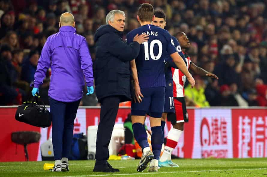 Harry Kane limps past José Mourinho after sustaining the injury against Southampton on New Years' Day.