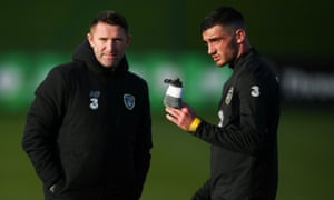 Troy Parrott chats to Republic of Ireland assistant coach Robbie Keane during a training session on Wednesday.
