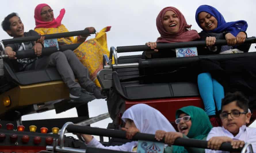 Fun-fair rides at the Eid festival in Small Heath Park, Birmingham.
