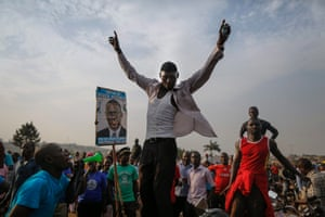 Supporters of Kizza Besigye cheer as they wait for his arrival at a campaign rally in Kampala