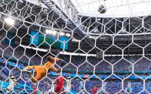 Russia's Aleksei Miranchuk scores their first goal.