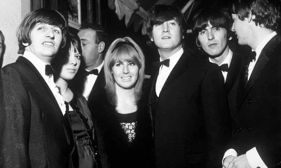 The Beatles with Cynthia Lennon at centre attend the premiere of A Hard Day's Night, July 1964. She and John divorced in 1968 after a six-year marriage.