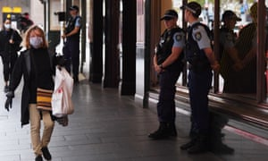 NSW police stand guard outside a hotel in Sydney on Thursday that has been declared a 'human health response zone'.