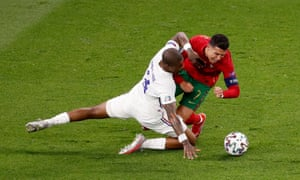 Portugal's Cristiano Ronaldo is fouled by France's Presnel Kimpembe.