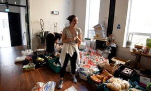A volunteer from a Mutual Aid group in Islington, north London, prepares food parcels.