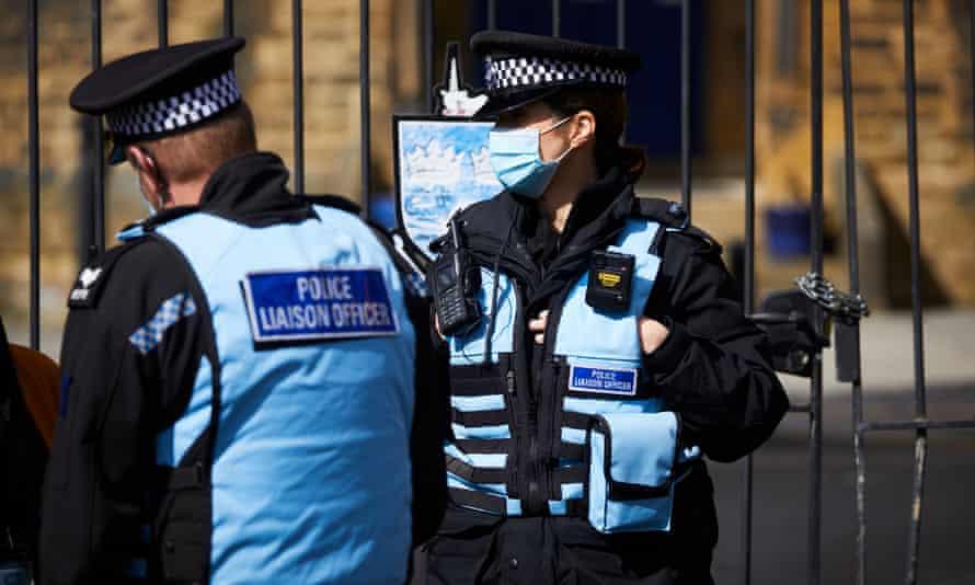 Two police liaison officers outside Batley grammar school
