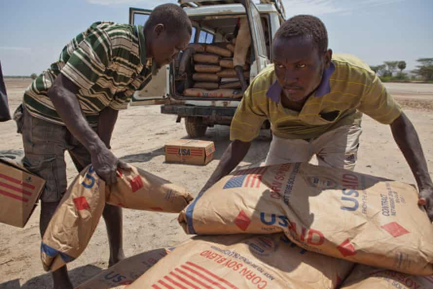 Villagers transport supplementary food provided by the UN World Food Programme during the drought in 2011.
