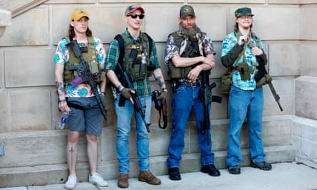 Armed protesters demonstrate outside the Michigan state capitol.