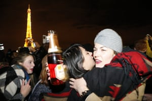 People celebrate near the Eiffel Tower in Paris