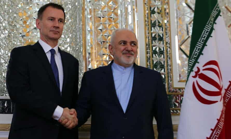 Jeremy Hunt (left) with Iran's foreign minister, Javad Zarif, in Tehran.