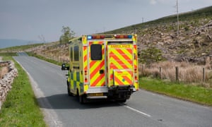 Ambulance on rural road going to an emergency in Yorkshire, UK