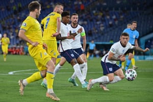 England's defender Kieran Trippier (right) dives to block a cross.