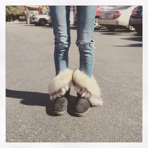 A girl in a car park in Dallas, Texas shows off her warm boots, bought for her by her mum. Not real fur