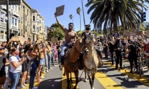 Demonstrators rally in San Francisco's Mission District.