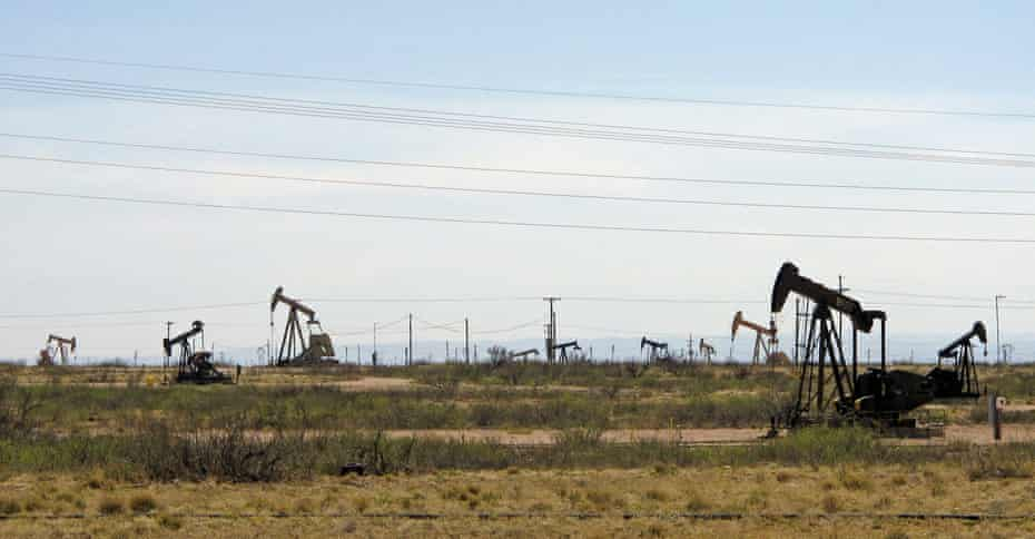 Oil rigs stand in the Loco Hills field on US highway 82 new Artesia.