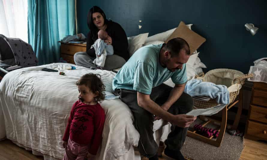 Kelsie and Shaun with their two children … 'We keep getting ill and we're living in clutter all the time.'