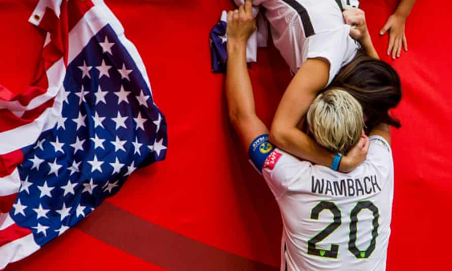 Abby Wambach kisses her then wife after the 2015 World Cup final