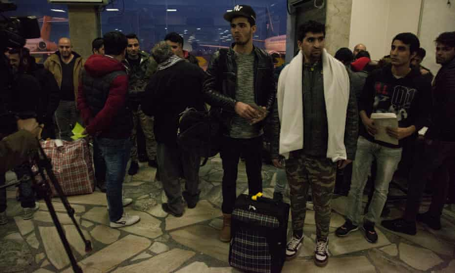 Asylum seekers expelled to Afghanistan from European countries including Germany, Norway and Sweden arrive at Kabul airportA