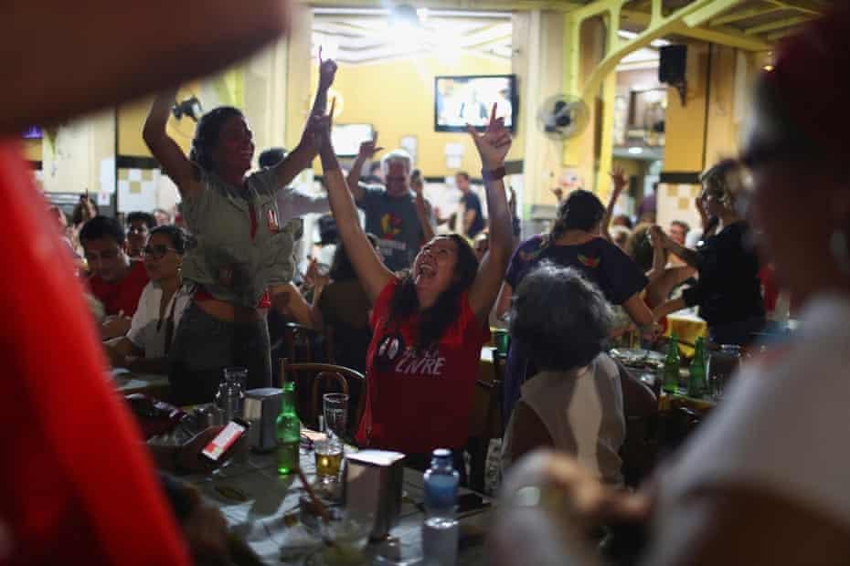 Supporters of the former president Luiz Inácio Lula da Silva celebrate his release from prison at a bar in Rio de Janeiro, Brazil, 8 November