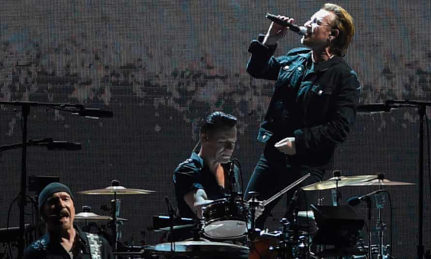 Bono, right, Larry Mullen Jr and Edge during a U2 concert in Mumbai in 2019.