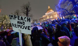 Protesters gathered on Boston Common near the Massachusetts state house during a rally calling for the impeachment of Trump in Boston, Massachusetts.