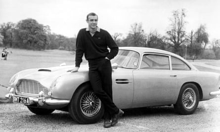 Sean Connery as James Bond in Goldfinger with Aston Martin, 1964.