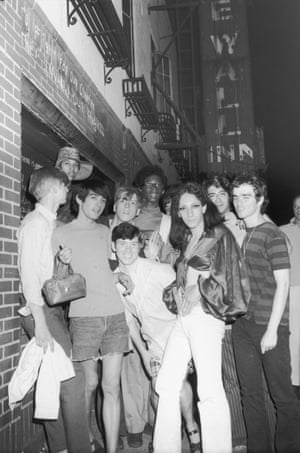 A group of young people–including Tommy Lanigan -Schmidt on the far right–celebrate outside the boarded-up Stonewall Inn (53 Christopher Street) after riots over the weekend of June 27, 1969.
