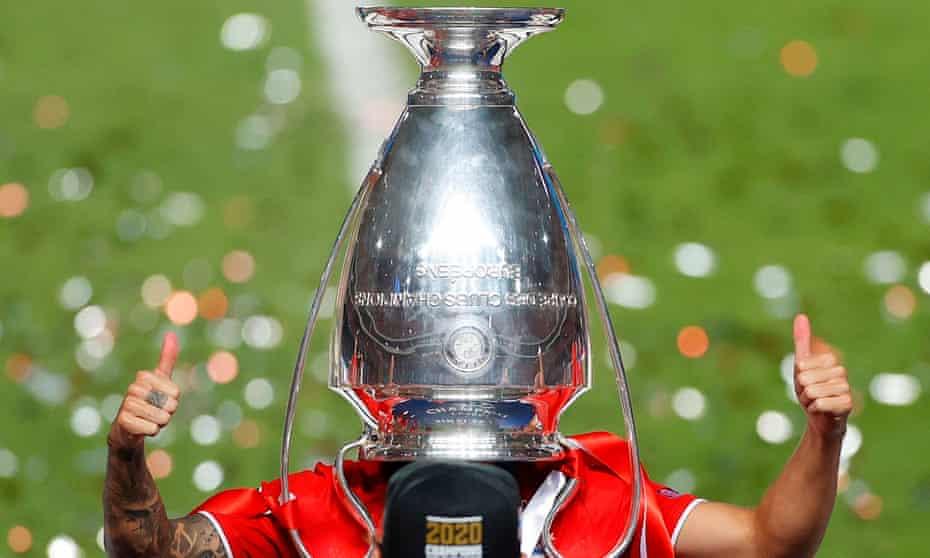 Lucas Hernandez celebrates after winning last season's Champions League final with Bayern Munich.