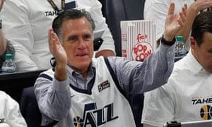 Utah Senate candidate Mitt Romney cheers on the Jazz