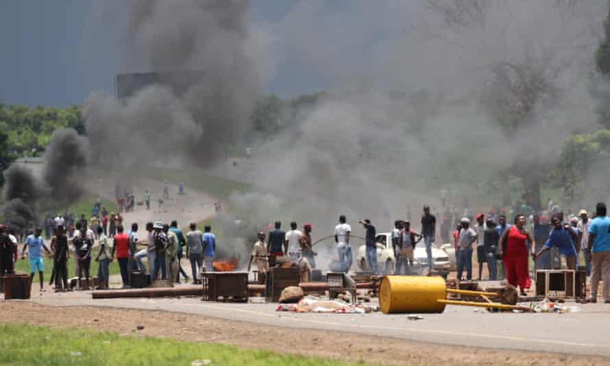 Zimbabwean protesters block a major road leading into the city centre of Harare.