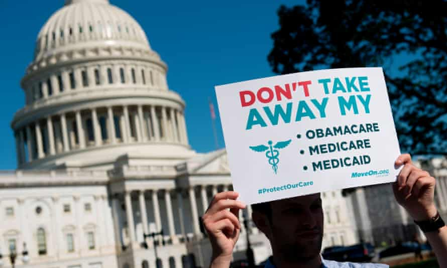 Protests against the Republicans' healthcare bill hold a rally outside the US Capitol in Washington