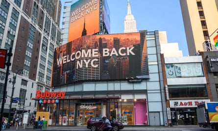 A billboard in New York City heralds its reopening.