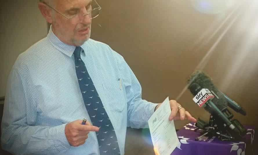 Euthanasia campaigner Philip Nitschke sets fire to his medical practising certificate in Darwin on Friday.