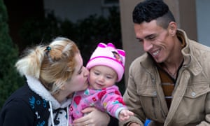 Iraq Refugees in SeattleShatha Sulaiman Kheder, her son Steven Adil Kheder, 10 months, and husband Adil Kheder Nimr share a moment outside their new apartment in Washington state.