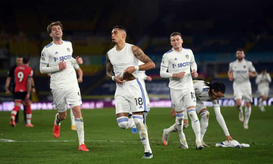 Raphinha (centre) celebrates after scoring Leeds' third goal with a fine free-kick.