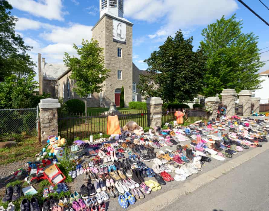 A tribute in front of the St Francis Xavier Mission, for the 215 children buried in an unmarked mass grave on the grounds of the former Kamloops Indian residential school, in Kahnawake reserve, Canada.