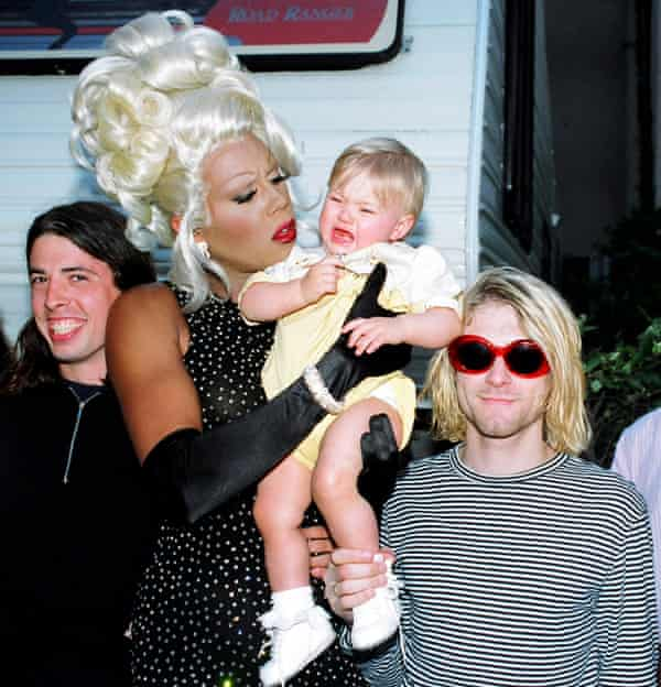 RuPaul holds the baby with with Dave Grohl, left, and Kurt Cobain of Nirvana.