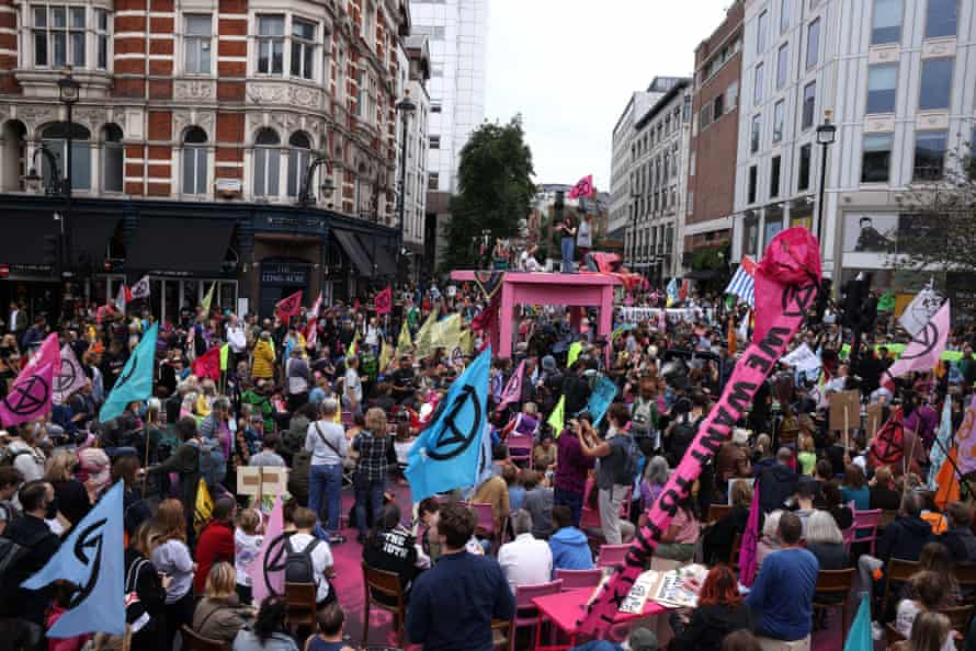 Extinction Rebellion protesters gather in Covent Garden area on August 23, the first day of the group's latest 'rebellion'.