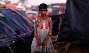 An eight-year-old Rohingya girl inside a refugee camp near Cox's Bazar, Bangladesh. The report is based on 65 interviews with Rohingya who recently arrived in Bangladesh.