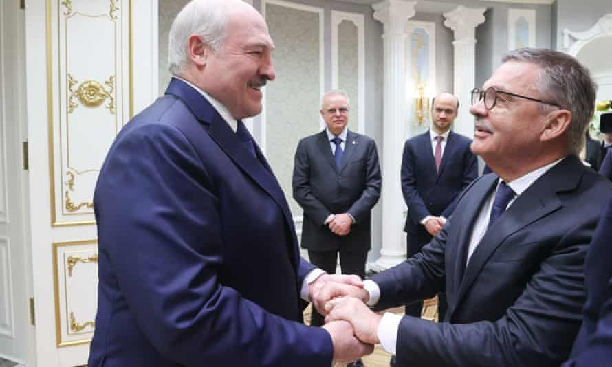 Alexander Lukashenko (left) with the IIHF chief, René Fasel, on 11 January.