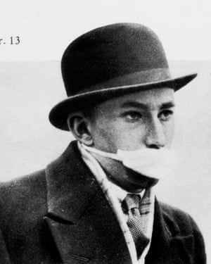 A man wears a mask during the Spanish flu of 1918.