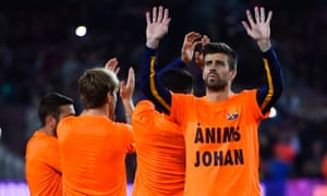 Gerard Pique of FC Barcelona wears a T-shirt reading 'Anims Johan' (Cheer up Johan) giving encouragment to former FC Barcelona Johan Cruyff