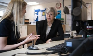 Theresa May meets a helpline advisor during a visit to the Young Minds mental health charity in London.