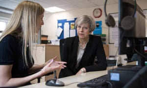 Theresa May meets a helpline adviser at the Young Minds mental health charity during the election campaign in summer.