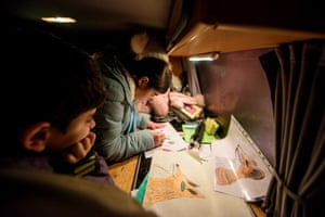 Refugee children draw animals while waiting for foxes to show up in Spandau.