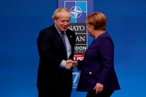 Boris Johnson shakes hands with the German chancellor, Angela Merkel